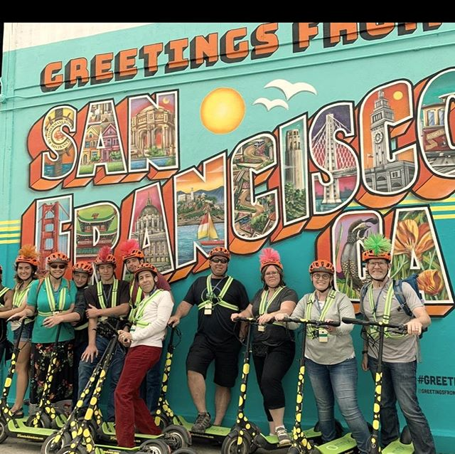 """Check out the new """"Greetings From"""" mural in San Francisco @greetingsfromsanfran . Mural also has a streaming webcam at Http://greetingsfromsanfran.com   Please check the mural Facebook page and Instagram to learn about the mural artist @maxfieldbala . . Labor Day Sale on San Francisco Segway and Electric Scooter tours! Start your Segway or E-Scooter adventure in @fishermanswharf or in  E-scooter fully guided tours start in @fishermanswharf and go to the @golden_gate_bridge and back. or start in Golden Gate Park and scooter to Ocean Beach and back.   Enter or mention code """"LABORDAY"""" to save $10.00 per person. Get out and glide through San Francisco waterfront or beautiful Golden Gate Park this Labor Day weekend  Call 415-474-3130 for reservation or use the LABORDAY coupon when you book online https://electrictourompany.com/  Valid 8/30-9/2/19. No Cash Value. Not valid with other discounts or coupons.  . . .  #longweekend  """